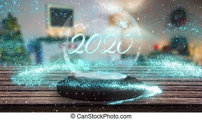 Animation of number 2020 written in white on a snow globe, blue shooting star and Christmas tree in the background