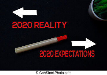 2020 Reality or 2020 Expectations write on black board background.