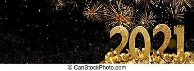 2021 golden figures standing glitters in firework in the night