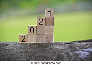 2021 number on wooden block with blurred background. 2021 new year concept