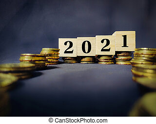 2021 number written on wooden blocks background. Business concept.