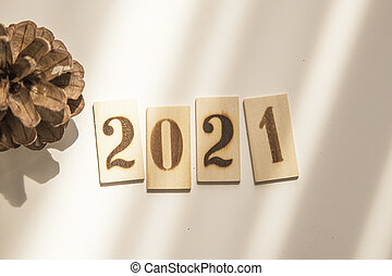 2021 year concept. Wooden Blocks With text on table.