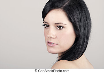 20s Woman on Grey Background