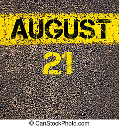 21 August calendar day over road marking yellow paint line