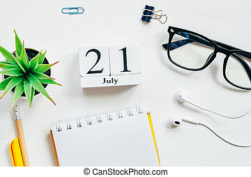 21st july - twenty first day month calendar concept on wooden blocks.