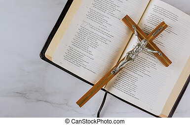 Jesus on way to God through prayer with cross is placed on top of the Holy Bible.
