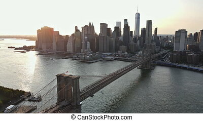 Amazing view on Brooklyn Bridge and Manhattan over East River at sunset, New York USA