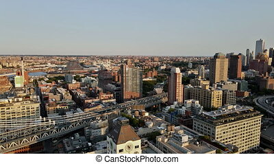 22 SEPTEMBER 2020 NEW YORK NY USA: NYC cityscape panning of downtown Brooklyn district with Manhattan Bridge beautiful aerial skyline New York City