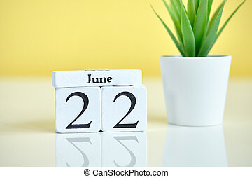 22 Twenty second day june Month Calendar Concept on Wooden Blocks.