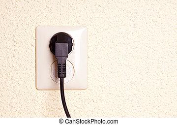 Outlet with plug against a textured backgrund - 220V Outlet...