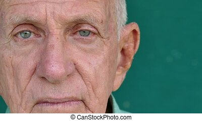 Portrait of sad old people with emotions and feelings. Worried hispanic senior man looking at camera with depressed expression on face. Active retired elderly grandfather. Closeup, copy space