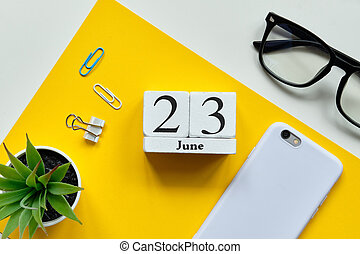 23 twenty third day june Month Calendar Concept on Wooden Blocks.