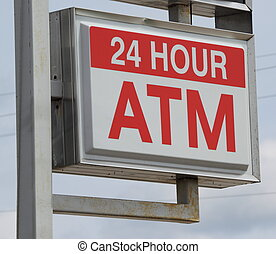 24 Hour ATM Sign - A 24 hour ATM automated teller sign on a...