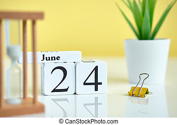 24 twenty fourth day june Month Calendar Concept on Wooden Blocks.