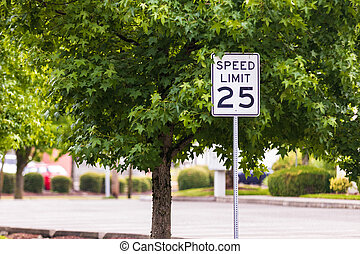 mph sign with a tree and concrete road