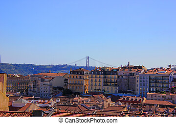 25 of april bridge (ponte 25 de abril) over the tejo river, seen from the alfama, the old town in lisbon
