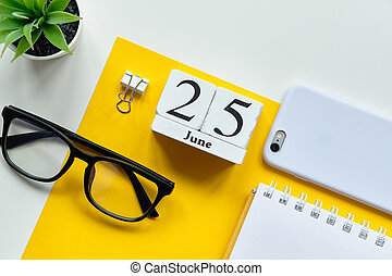 25 Twenty fifth day june Month Calendar Concept on Wooden Blocks.