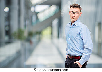 25 year old entrepreneur in blue shirt in office