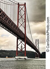 25th April Bridge in Lisbon on a cloudy day
