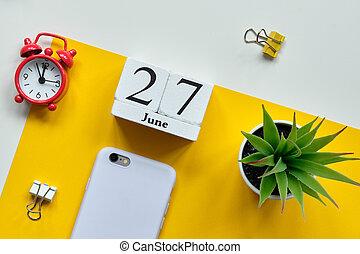 27 twenty seventh day june Month Calendar Concept on Wooden Blocks.