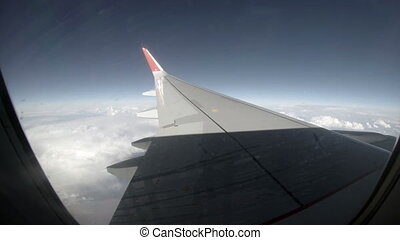 2.7K. Airplane wing out of window