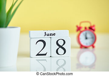 28 twenty eighth day june Month Calendar Concept on Wooden Blocks.