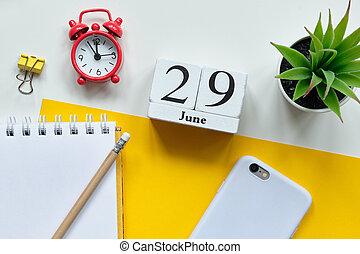 29 twenty ninth day june Month Calendar Concept on Wooden Blocks.