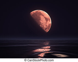 red moon rising over the ocean