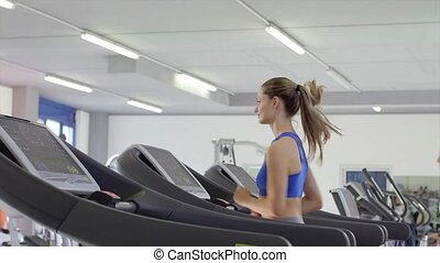 2of27 People training in gym