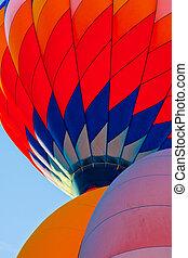 3 Balloons Rising in Morning Sun