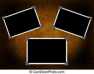 3 Blank photo frames on background