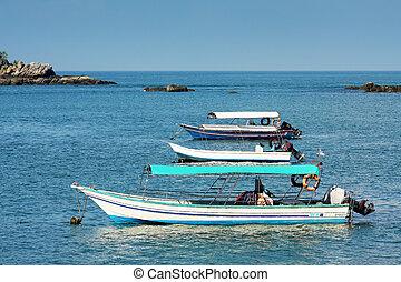 3 boat on blue lagoon
