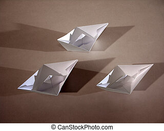 3 boats on bronze - Three origami paper boats on bronze.
