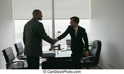 3 Business People Shaking Hands At Office Meeting With Advisor