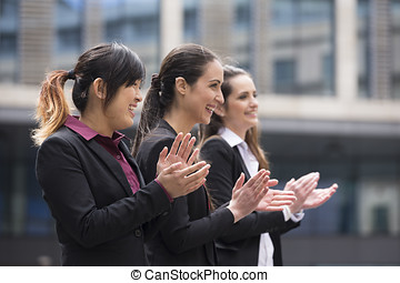 3 Business women clapping