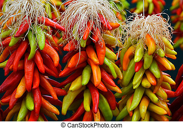 3 Chile Ristras - Three freshly strung ristras with assorted...