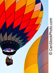 3 colorful balloons in blue sky