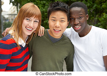 3 intercultural people laughing together