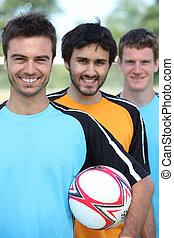 3 football players