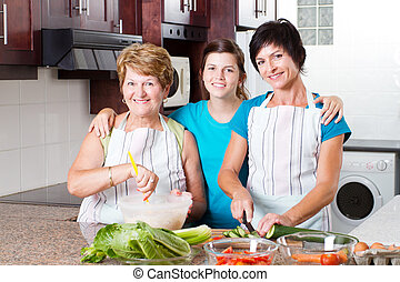 3 generations family cooking in kitchen