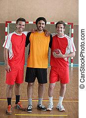 3 handball players