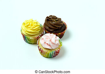 3 homemade cupcakes isolated on a white background