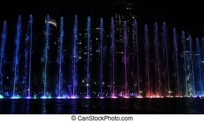 3 in 1 video. Evening view at colorful fountain