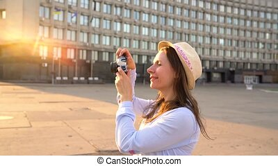 3 in 1 video. Girl is walking around the city and taking photos of sights on a film camera