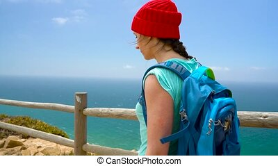 3 in 1 video. Woman with a backpack enjoys a view of the ocean coast in various picturesque places of Portugal