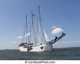 3 masted scooner sailing along the dutch coast