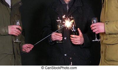 3 men celebrating new years eve - 3 men chatting and...