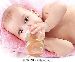 3 months adorable baby girl drinking from plastic bottle in...