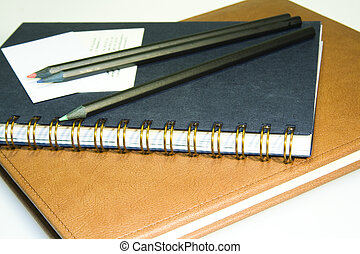 3 pensil 2 bisnesscard 2 notebooks