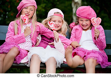 3 playfull sisters - Happy children having pink clothes and...